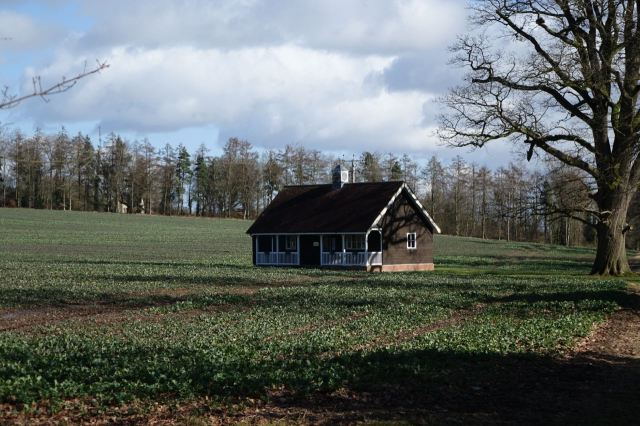 Nearby finding what looks like Dorothy's house from 'The Wizard of Oz' casually set down in a field.