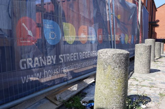 Across at Granby 4 Streets we find bollards protecting the site signage.