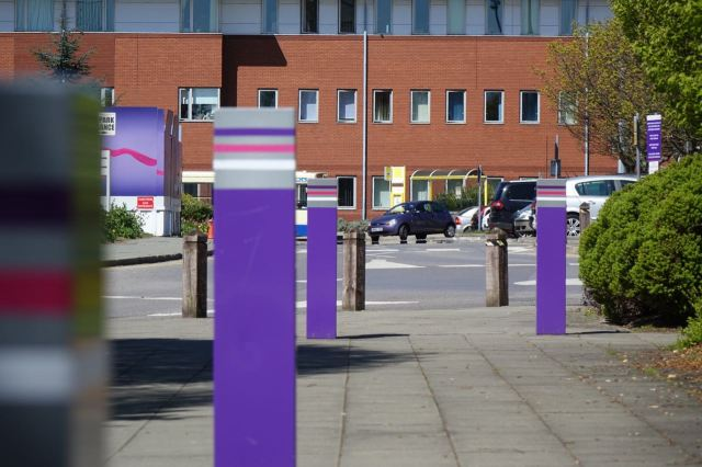 With whole armies of bollards in the gaps between them.