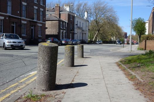 Immediately greeted by some purposeless left over from history bollards.