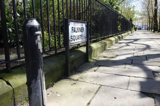 Finding that even the street sign has its own protective bollard.