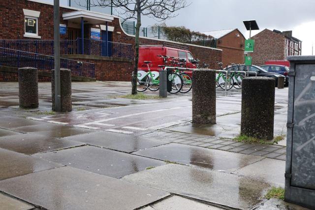 The bollards do part politely to let bikes through though.