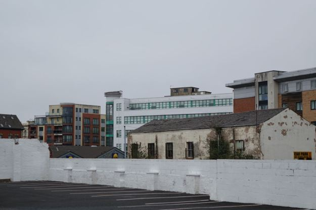 Along the road, an opening onto visions of student housing and an interesting old department store.