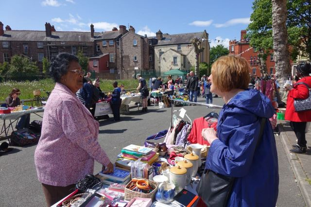 Resident Maria Bassey talks with veteran Street Market vendor Diane Jensen.