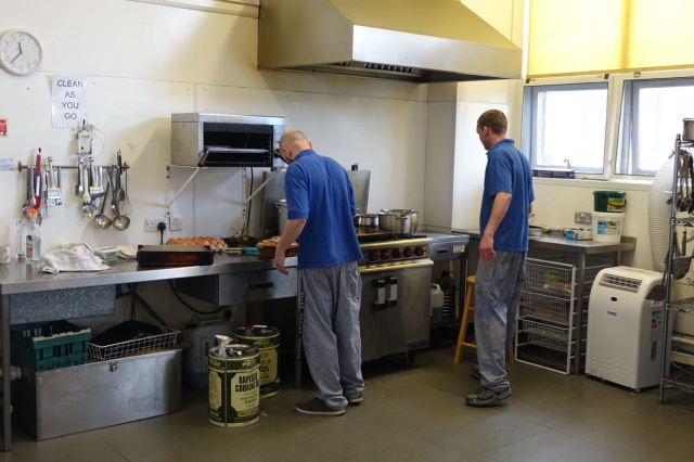 Preparing food for the Community, and also for the café they run in the shop downstairs.