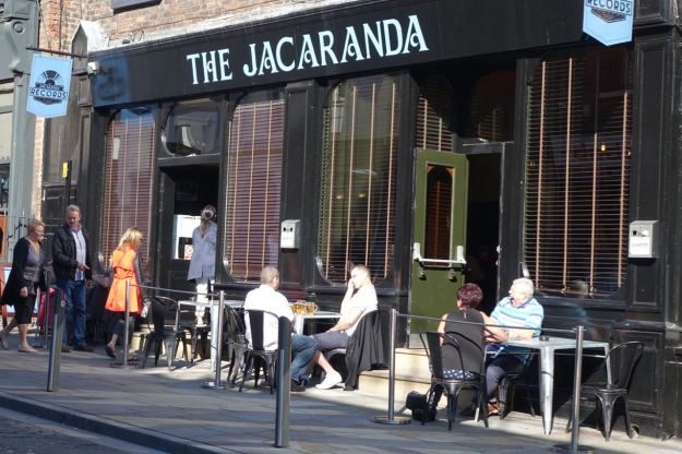 On Slater Street, the Jacaranda joyously open again. The Beatles once painted the basement here you know, one time when they were short of money and gigs.