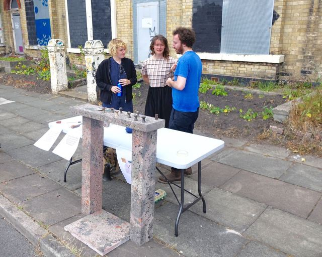 Our architects Assemble are here with one of their fireplaces, plus something else they've made for the Community Land Trust houses.