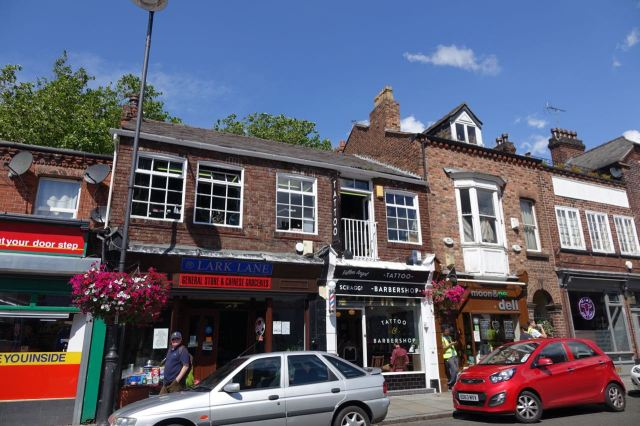The tatoo place used to be a bakery on the ground floor and a great café upstairs - back in the 1980s. Still miss it!