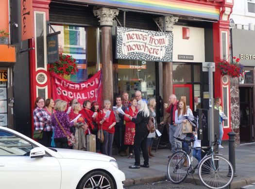 Outside News From Nowhere a group of Socialist Singers were exercising their right to a free song.