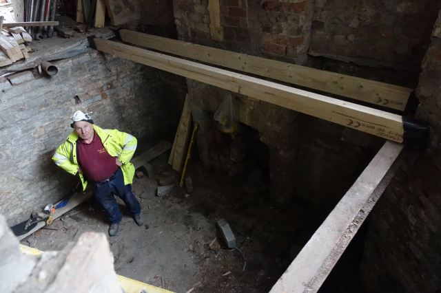 Revealing the full size basement below.