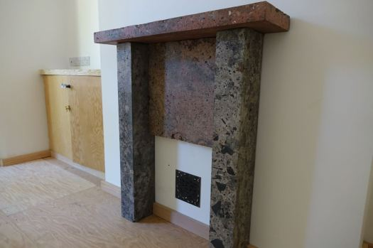 Fireplaces for each of the houses made from reclaimed and reworked rubble from within the houses themselves.