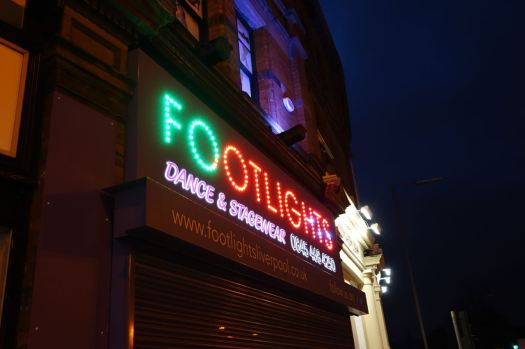Footlights with its dancing sign.