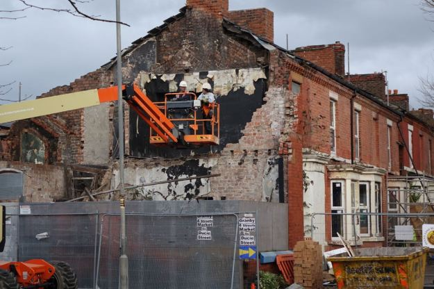 Demolition happening next to the Community Land Trust houses currently on site.