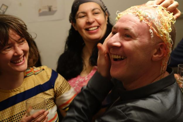 Paula from Granby Workshop admiring Michael's festive hair weave.