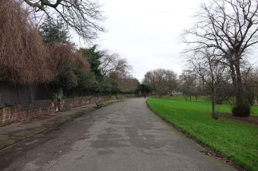 The bright day dwindling now I walk on through Princes Park.