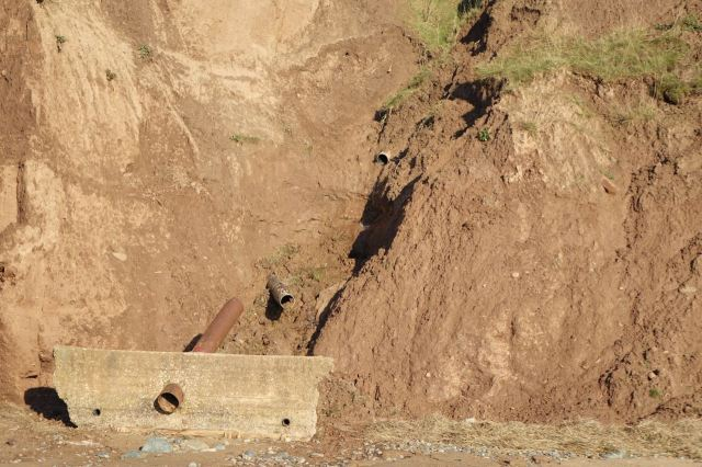 Even the drainage pipes in the cliffs have collapsed.