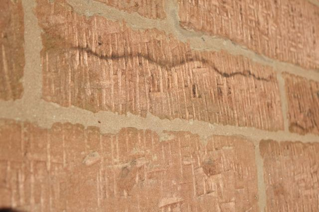 The chisel marks in the stone.