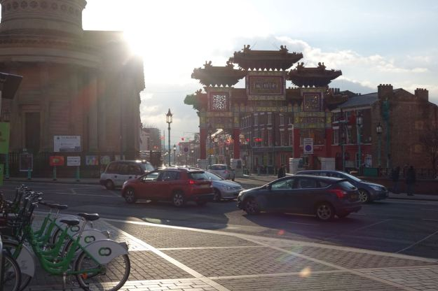 Let's go then. The sun beginning to set over Chinatown, decorations from New Year still up.