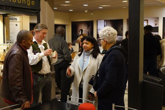 And here's my friend Tracey Gore, in the middle, talking with 3 people who are in the exhibition.
