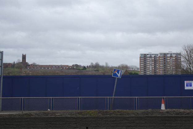 Opposite, Everton peering over the 'Project Jennifer' wall.