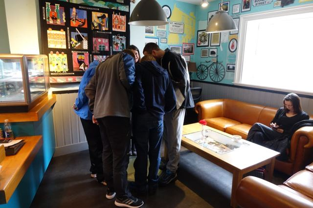 We go into the café and Maxine shows four first time visitors from Huyton round the local history display.
