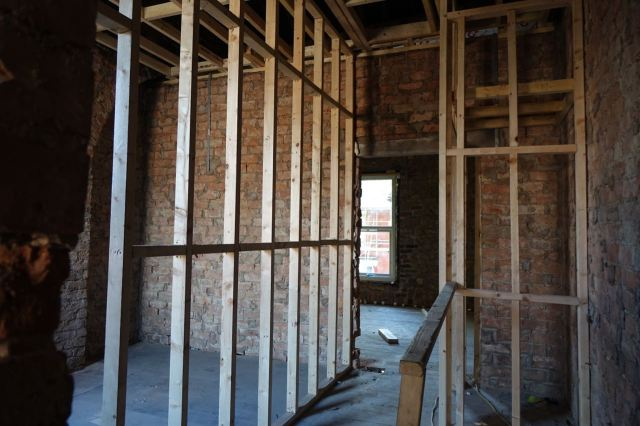 Upstairs the walls are going in.