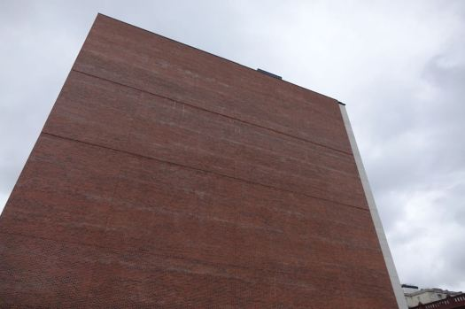 Then it's off past the largest brand new brick wall in the inner city.