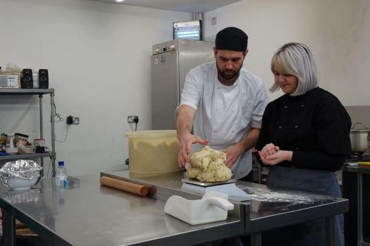 Ross and Cally making pastry for the pies.