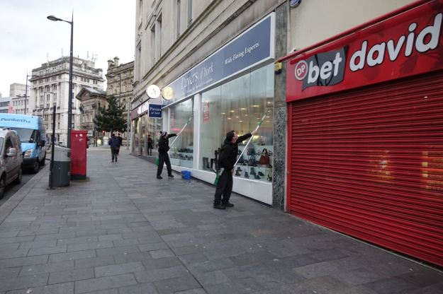With perfectly co-ordinated shop window cleaning.