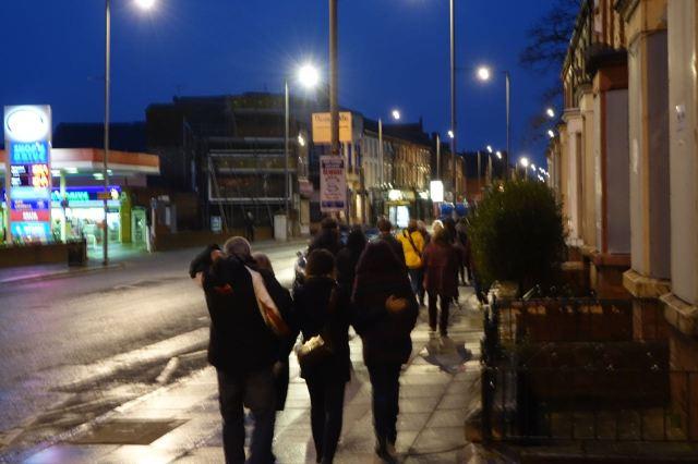 Then we walk in quiet procession in the rain.