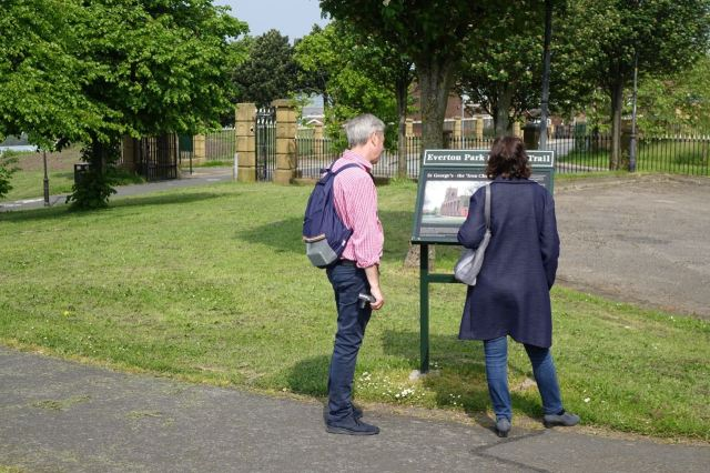 Me and the notice boards tell John and Michele the story of this place.