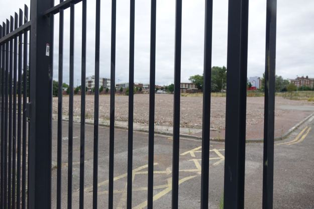 Fenced off land for whatever the University decided to do next.