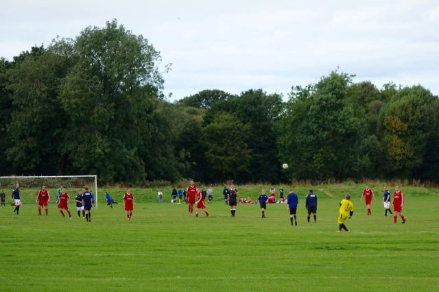 Glad to see several football matches being played as I walk across the fields.