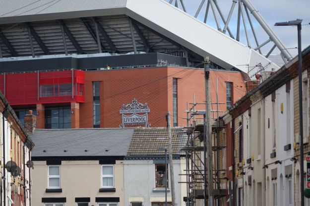 The new stand looming over the houses lucky enough to have escaped destruction for it.