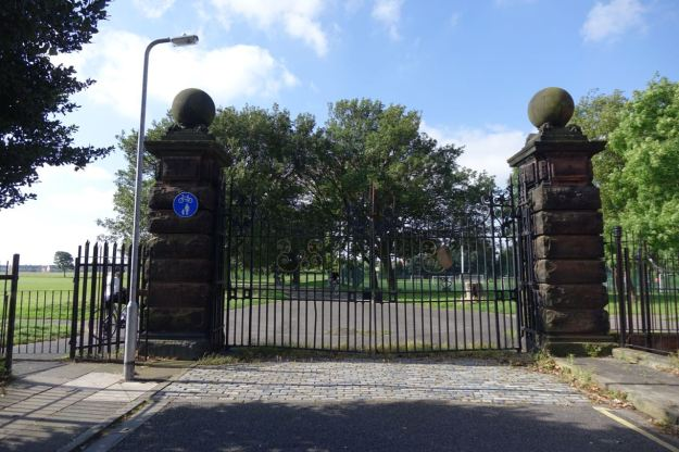 Leaving the park past these grand but never opened gates.