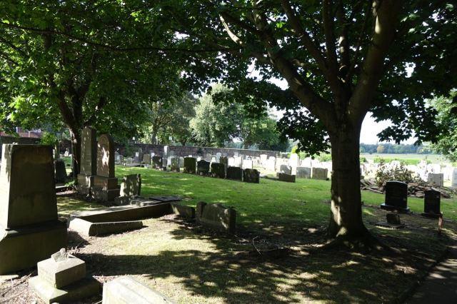 Into the graveyard at Holy Trinity.