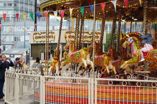 But no one could dislike the sounds of children laughing on a merry go round.