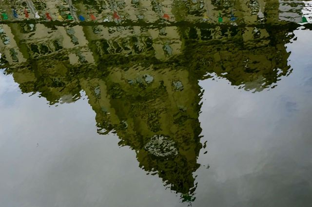 The Liver Buildings refracted in it.