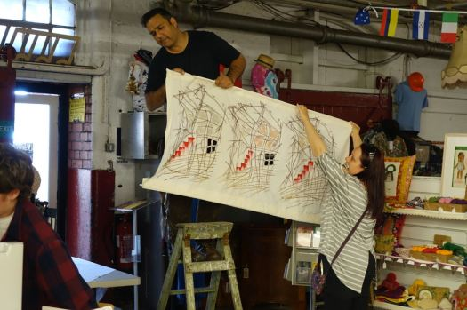Jan from Red Brick with Catherine Dalton hanging her as yet untitled fabric piece, specilly done for tonight.