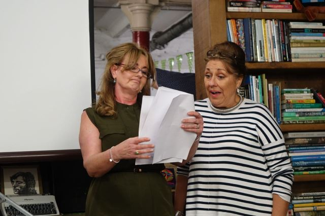 Back inside Liverpool novelist Deborah Morgan, with her friend Chris, performs an extract from her new play.