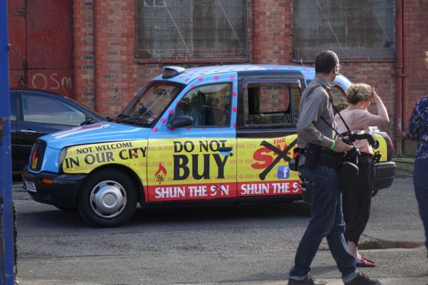 At first we think he's arriving in a 'Don't buy the S*n' taxi. And we're impressed.