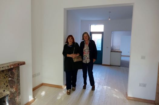 Naturally we go to Granby 4 Streets. Linda and Sarah inside one of the houses we're just about to sell.