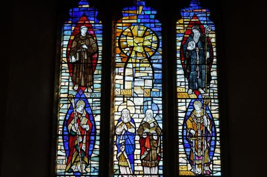 A recent addition is this stained glass window of their patron saints.