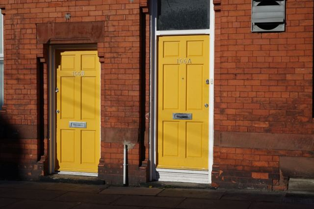 Across Aigburth Road, autumnal doors.