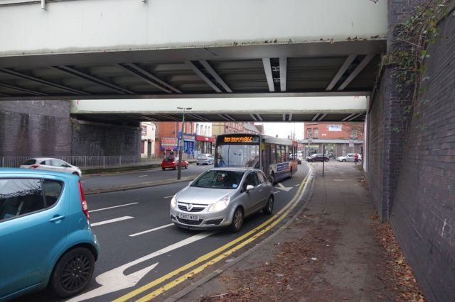 Under the railway bridge.