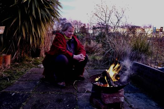 Here she is, content by her fire.