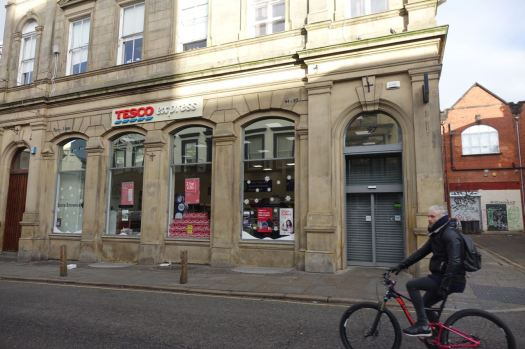 But just as I'm photographing the miracle of a closed Tesco, the rubbish on the street annoys someone else much more.