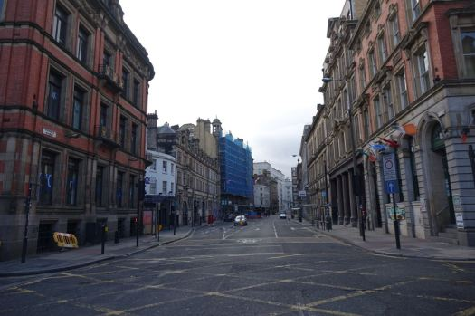 To deserted Victoria Street, where I stand in the middle of the road, facing one way...