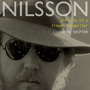 Today I sit here and continue reading this biography of Harry Nilsson.