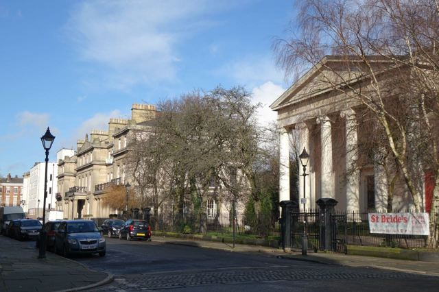Past Percy Street. St Bride's there in the sunshine.